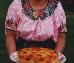 Maria Wearing a Huipil and Holding Pineapple Cake