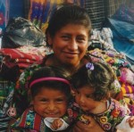 Guatemalan Woman and her Daughters Wearing Traditional Mayan Clothing